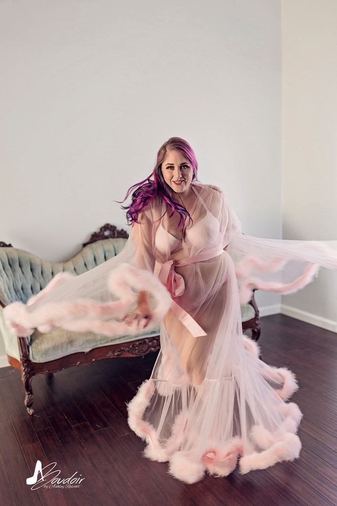 woman with purple hair twirling in robe