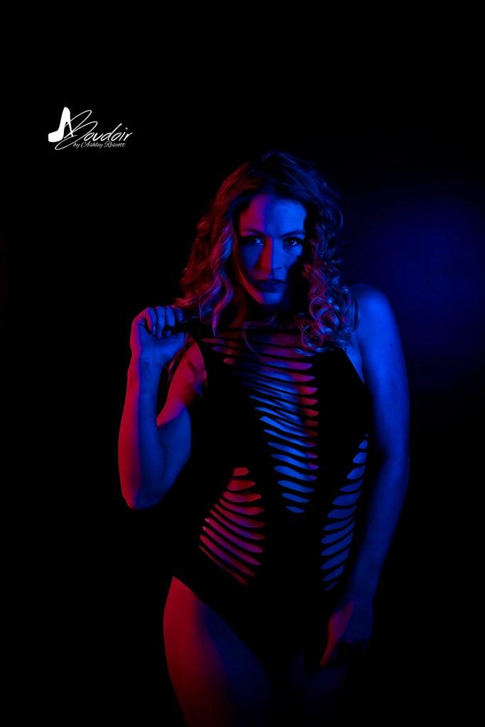 neon boudoir image of model in blue light