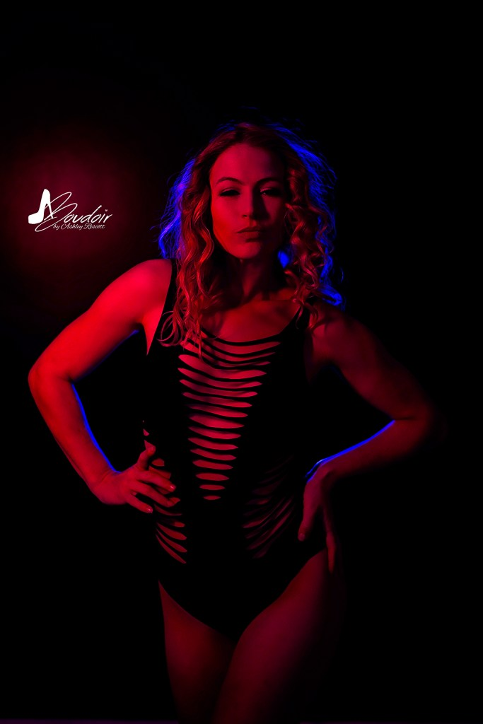 model in red light with pop of blue from behind