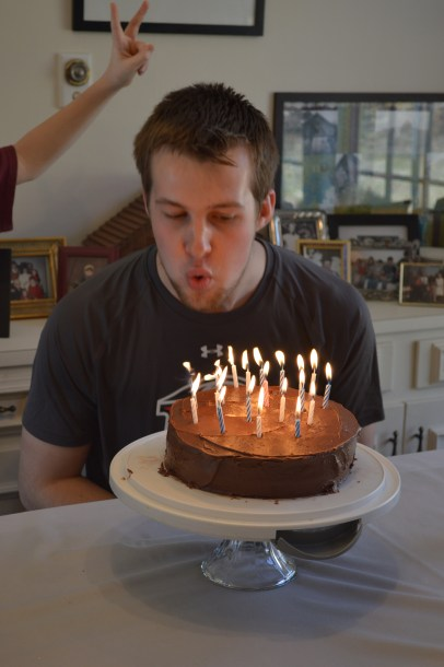 Blowing out the candles (notice my cousin doing bunny ears in the background)