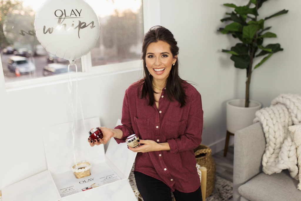 Top 3 reasons to use the new Olay Regenerist Whip fragrance Free moisturizer featured by top Los Angeles beauty blogger, Ashley Hodges: brunette woman wearing a red button up shirt and holding the new Olay Regenerist Whip frangrance free moisturizer