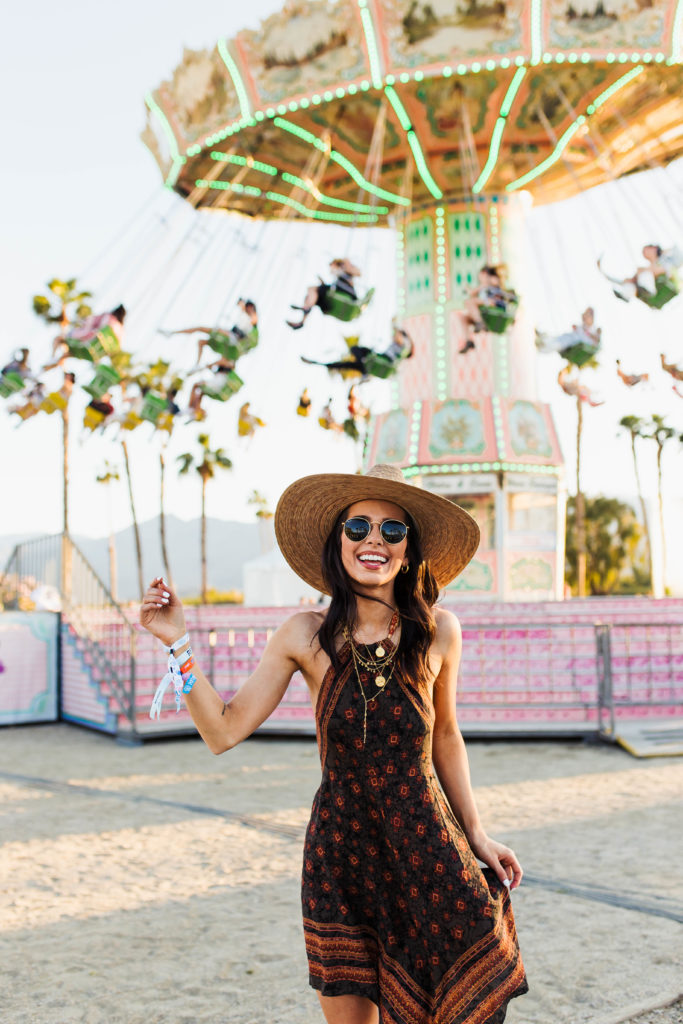 Revolve Festival Looks featured by top US fashion blogger Ashley Hodges; Image of a woman wearing dress at a theme park.