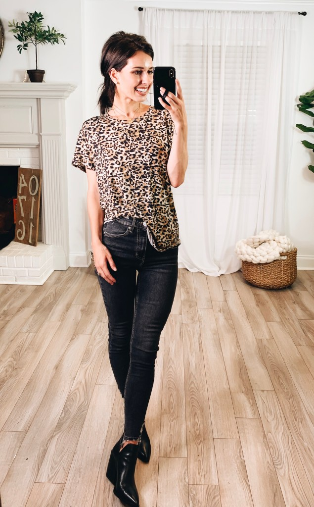 Nordstrom Anniversary Sale 2019 Try-On Haul by popular US fashion blogger, Ashley Hodges: image of woman standing inside her house wearing a Socialite Leopard Print Tee, Nordstrom Gigietta Bootie, Goodnight Necklaces, Nordstrom 3ct Cubic Zirconia Earrings, and Jamie High Waist Ripped Hem Skinny Jeans.