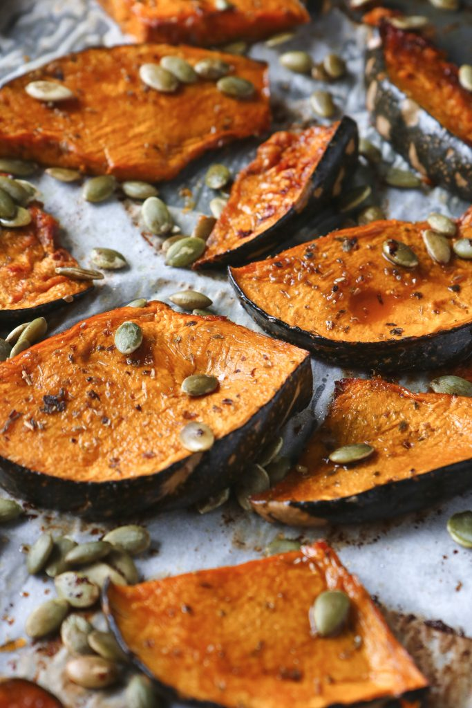 Maple roasted pumpkin with pepitas on a baking tray, fresh out of the oven