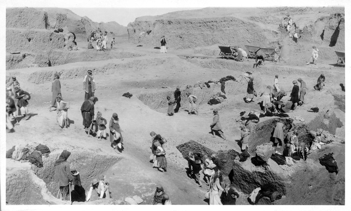 Black and white photograph of local people excavating a dig site