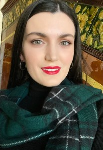 The Ashmosphere  - Pale girl with green eyes and dark hair wearing the Ancient MacLean tartan scarf