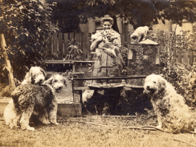 Emily Carr with her pets Prince Pumkin, Lady Loo, Young Jimmy, Adolphus the cat, Kitten, Chipmonk, and parrot in her garden at 646 Simcoe St, 1918. Photograph: Vancouver Art Gallery
