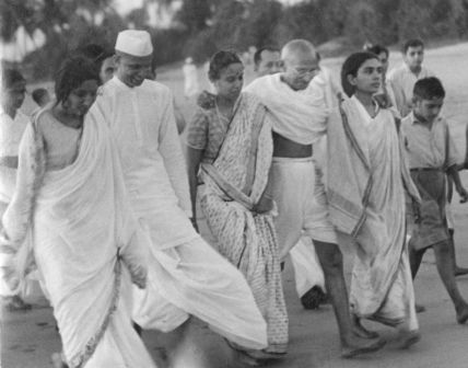 Ghandi walking on Juhu Beach, Bombay, 1936. Photo: Bert Scott