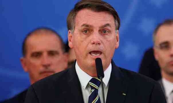 Jair Bolsonaro at a news conference in Brasilia on Friday. His dismissive reaction to the coronavirus crisis has sparked outrage across the political spectrum. Photograph: Ueslei Marcelino/Reuters