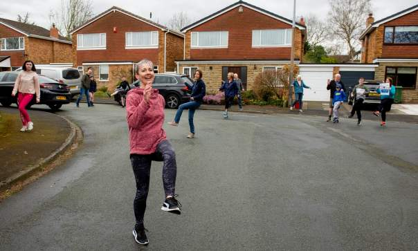 Woodcock, a freelance fitness instructor, leads the street-wide dance sessions at 11am each day. Photograph: Peter Powell/EPA