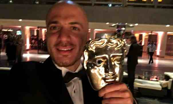 In a selfie with his Bafta for best factual series or strand, for Exodus.