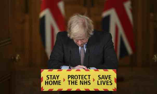 Head bowed, Boris Johnson leads a virtual press conference on the Covid-19 pandemic on Tuesday 26 January. Photograph: Justin Tallis/AP