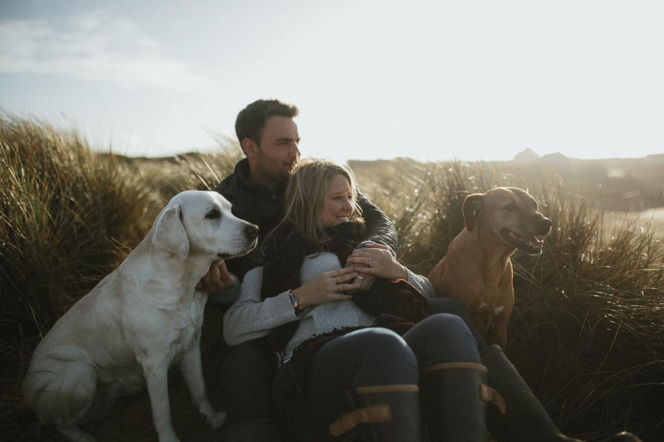 Couple with dogs at Cornwall Beach Engagement session