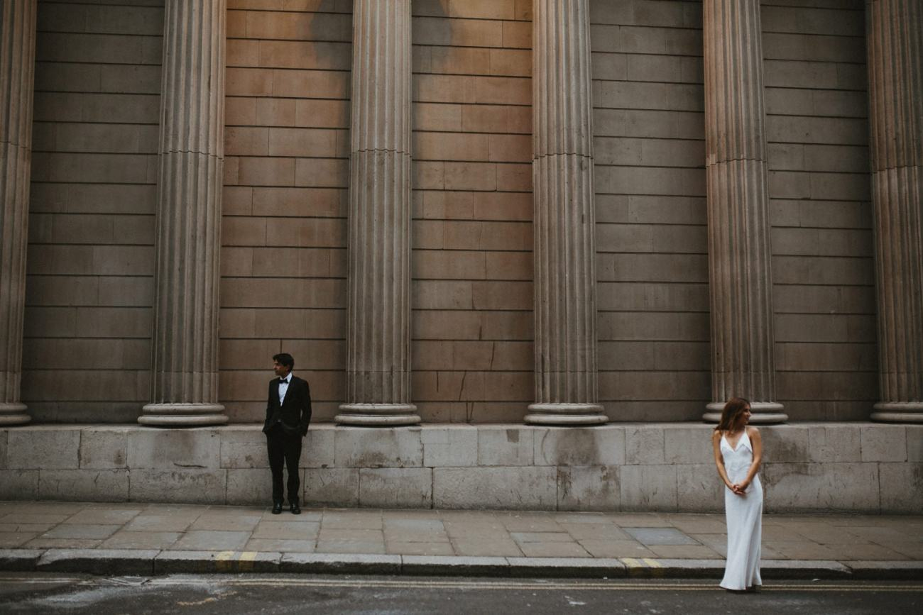 Bride and groom during wedding portraits in London at royal exchange building