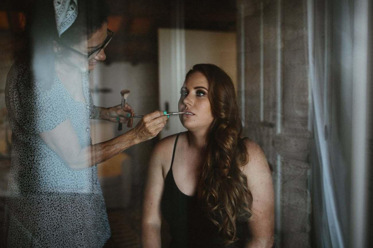 bride getting her makeup done at la garriga de castelladral