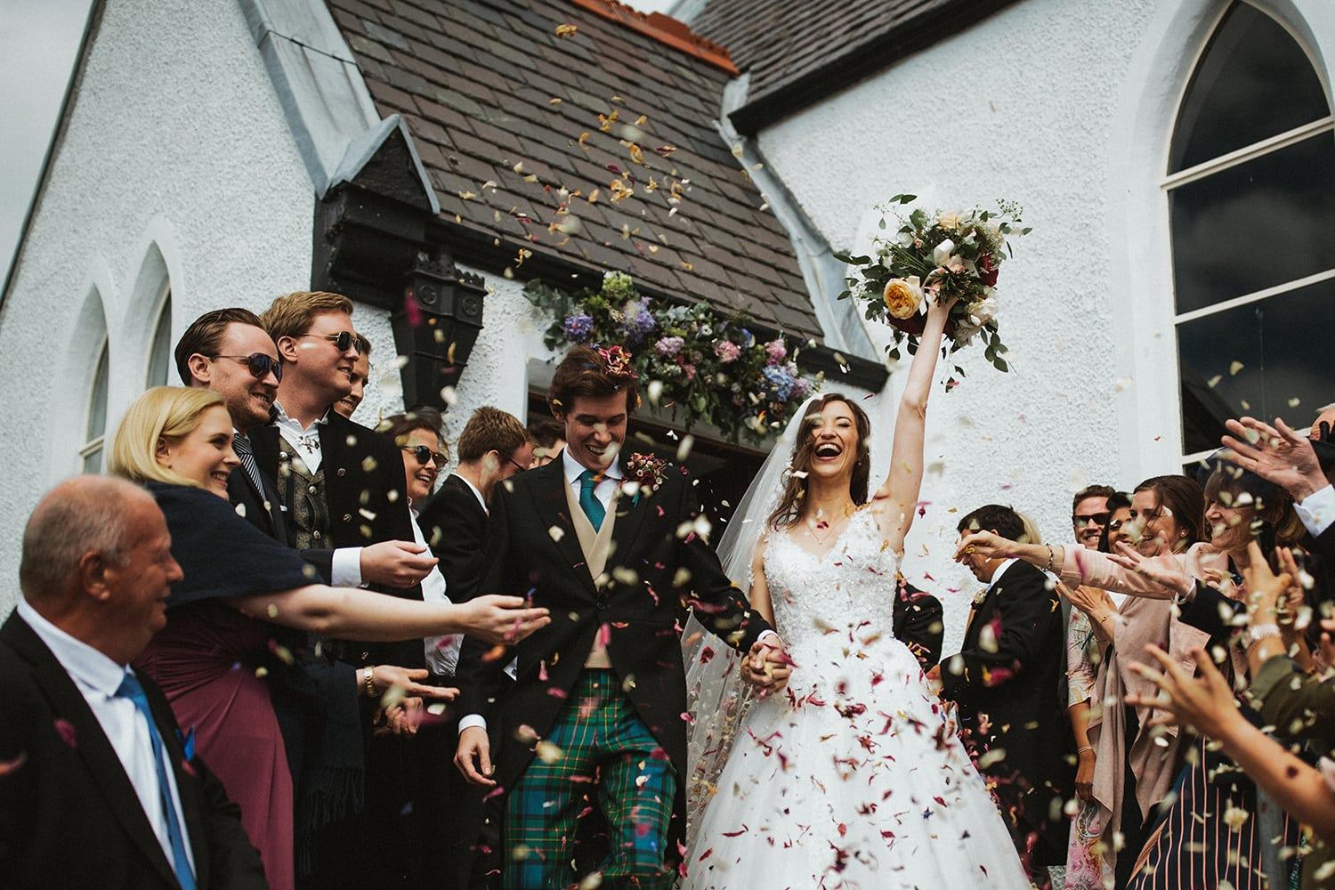 Bride and Groom confetti exit in Scotland Church in Mallaig