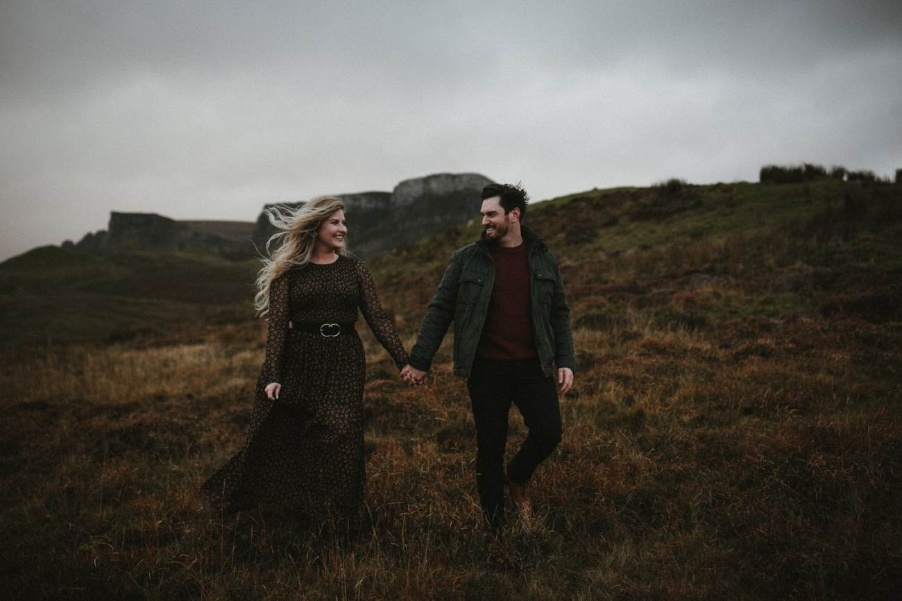 Couple walking together during Isle of Skye engagement session