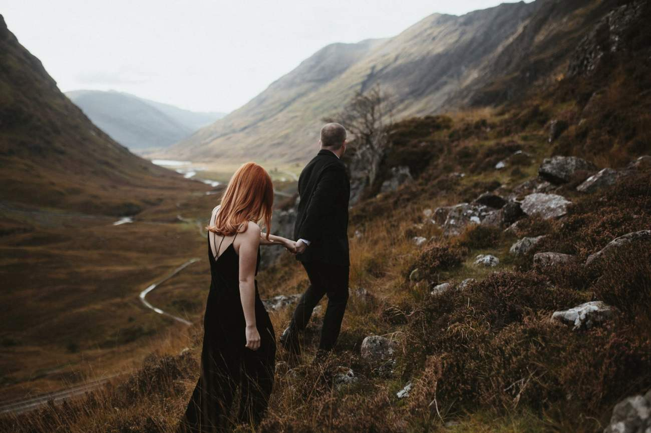 couple walking together in glencoe during their glencoe elopement in scotland