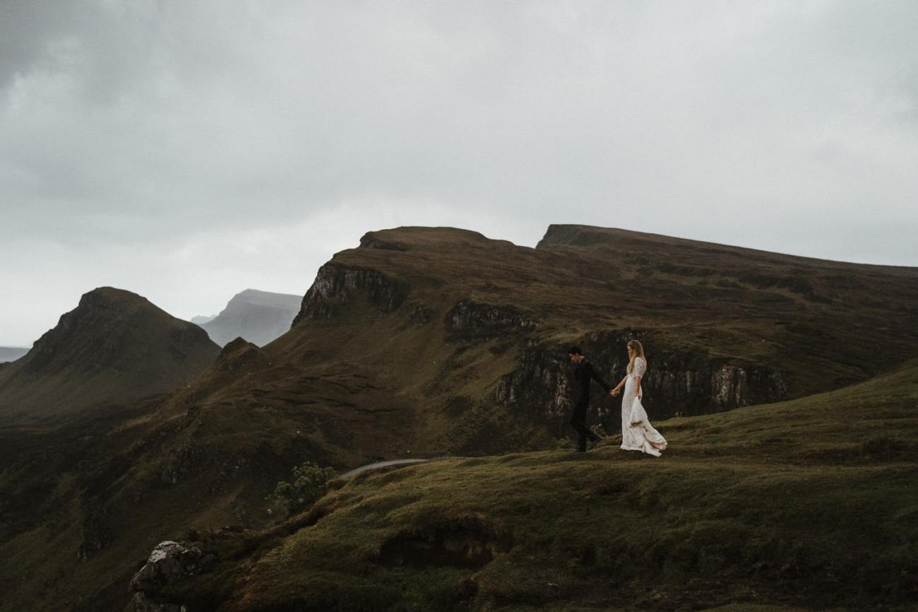 Bride and Groom walking along the Quiraing during their elopement in Scotland