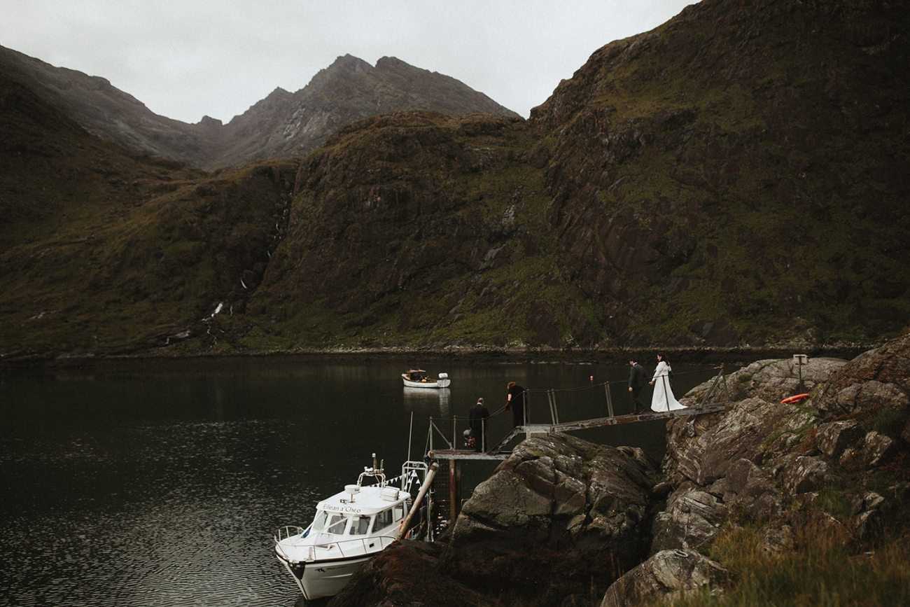 Bride and Groom getting on boat from Loch Coruisk