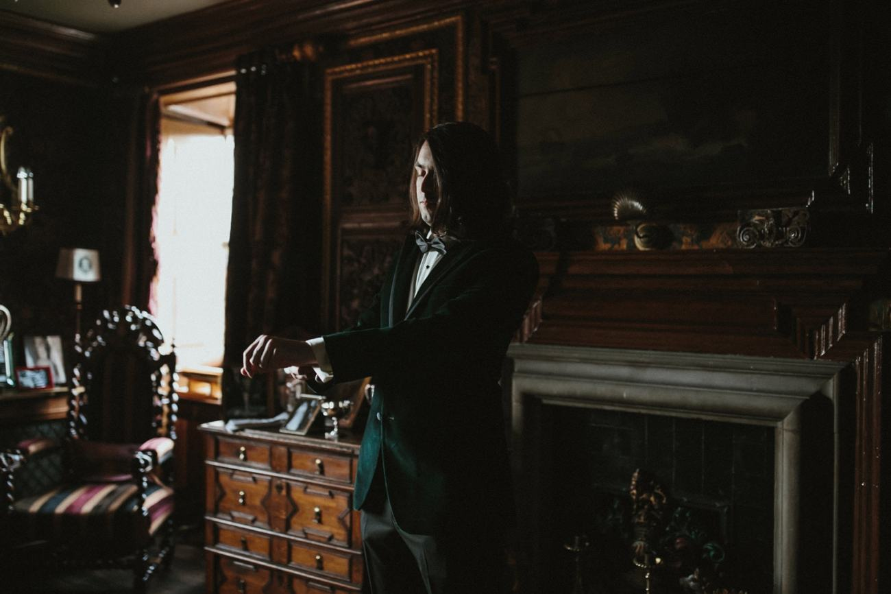 Groom wearing green velvet suit before his edinburgh elopement
