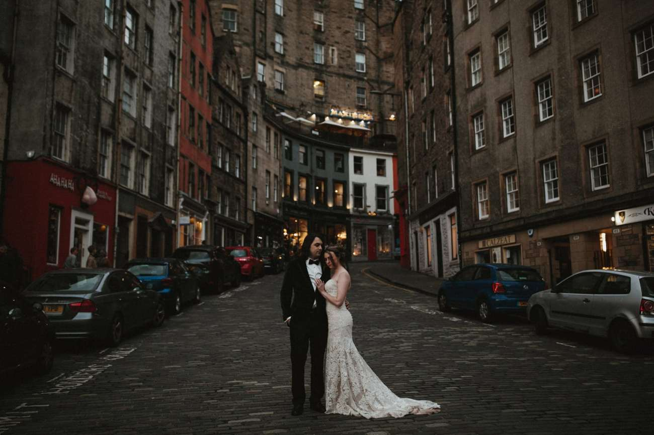 Bride and Groom standing in Victoria Street, Edinburgh