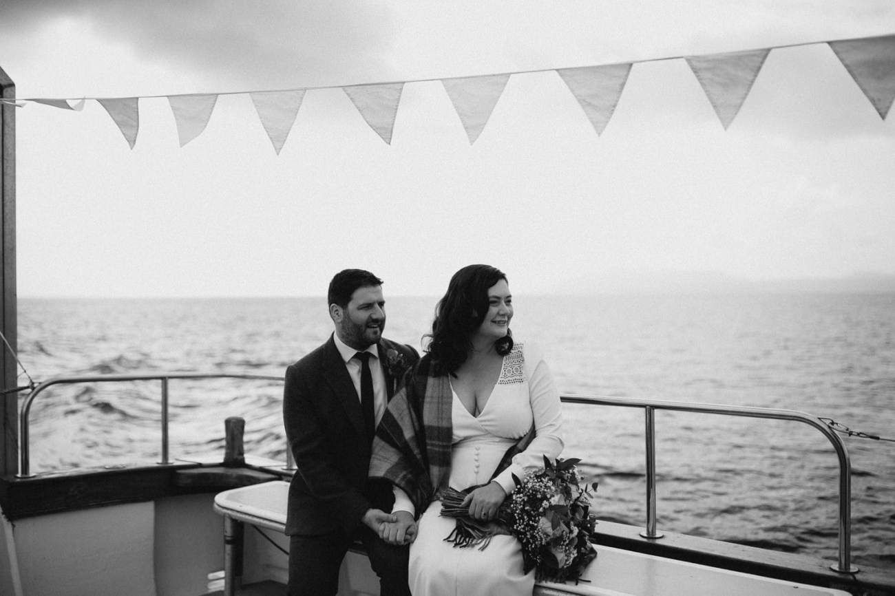 Couple taking boat to loch coruisk for their elopement
