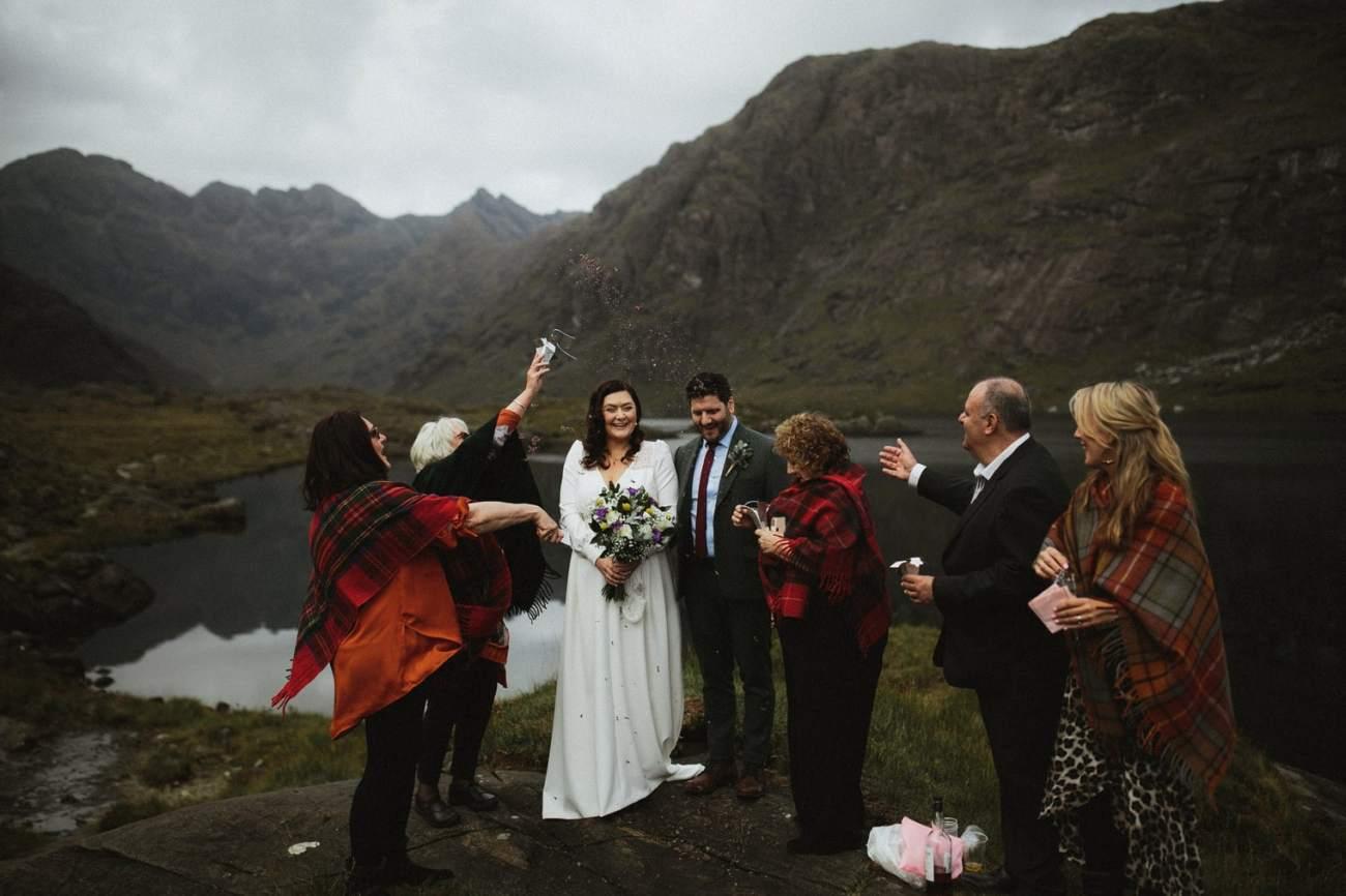 Confetti being thrown during Intimate Wedding at Loch Coruisk
