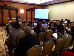 Scott Stroud offers welcoming remarks in the absence of Kassie Lamp, ASHR President