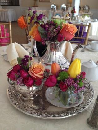 Silver Tea Service with Bright Floral Centerpiece