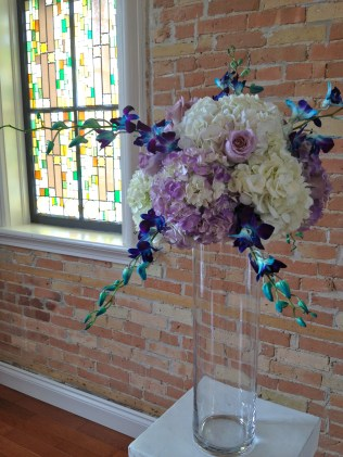 Altar flowers of hydrangea, purple roses and blue orchids