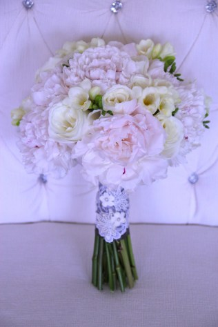 Bridal bouquetof blush peonies, white roses and freesia