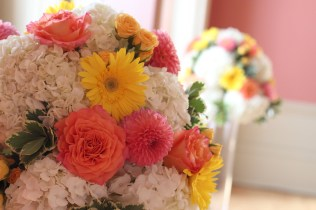 Coral and yellow altar flowers with roses, dahlia's, gerberas and hydrangea