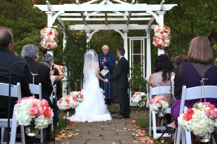 Coral, blush and peach wedding ceremony at Ancaster Mill