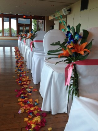 Tropical aisle markers with lilies, orchids and monestra leaves