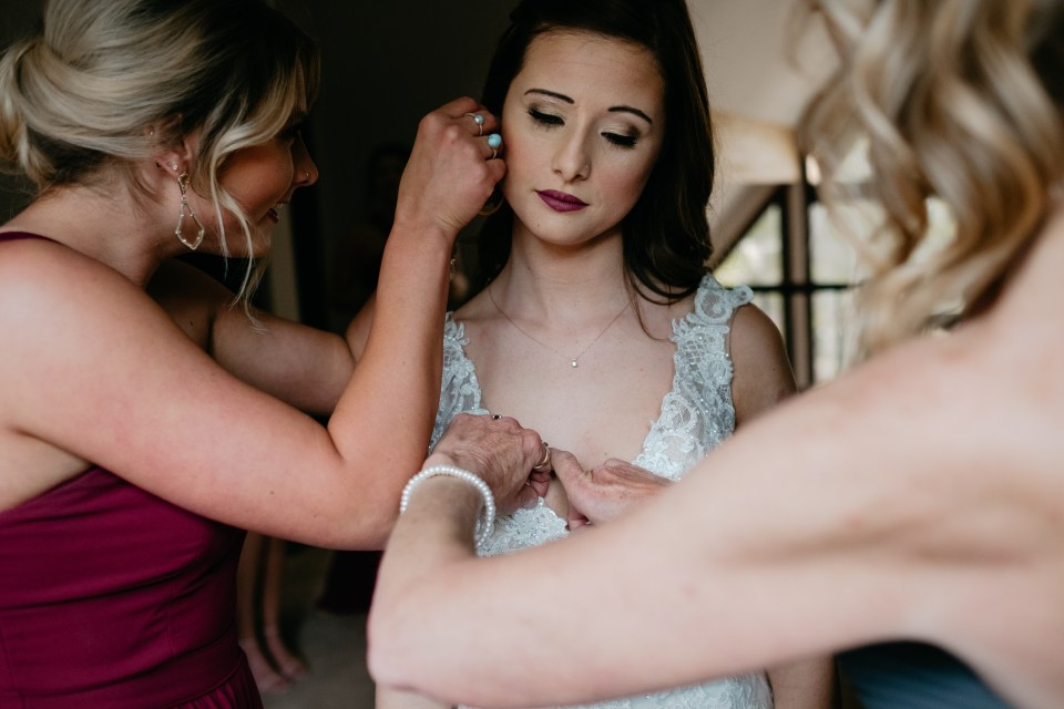 Skyler's mother and sister put the finishing touches on the bride.