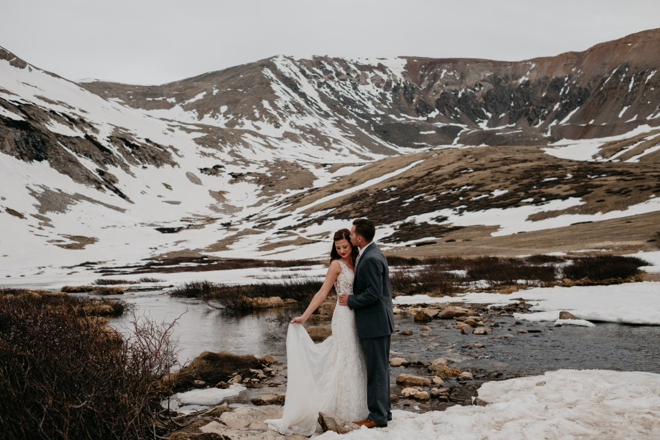 Skyler and Blayke pause for beautiful mountain portraits on their intimate wedding day.