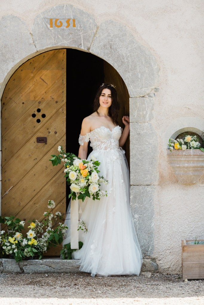 The bride dressed for her alpine elopement in a 17th century church.