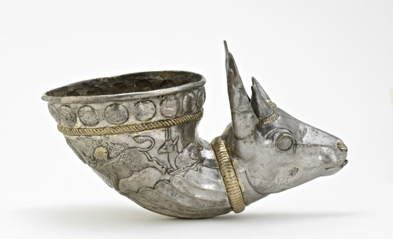 Sliver horn shaped cup with head of a gazelle at the tip.
