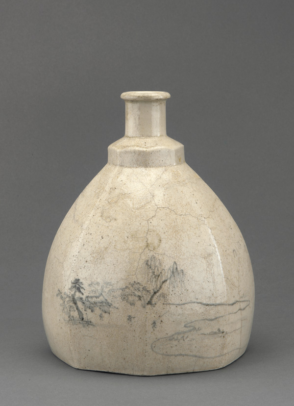 Off-white pear shaped bottle with minimalist landscape on front.