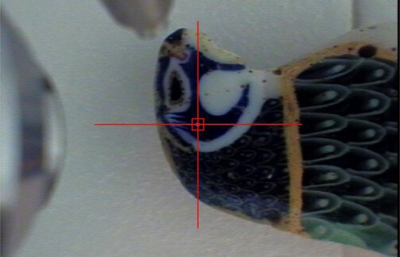 This image was taken with the XRF spectrometer camera of the glass object at top. The instrument allows us to focus the x-ray beam using a laser and video camera.