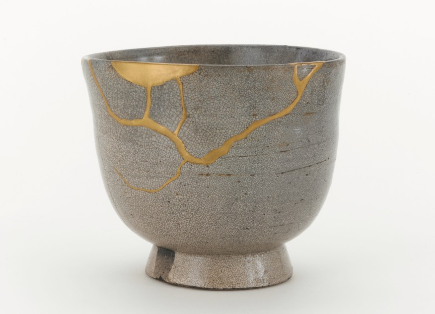 Tea bowl, possibly Satsuma ware; possibly Kagoshima prefecture, Japan, Edo period, 17th century; stoneware with clear, crackled glaze, stained by ink; gold lacquer repairs; Gift of Charles Lang Freer, F1904.323