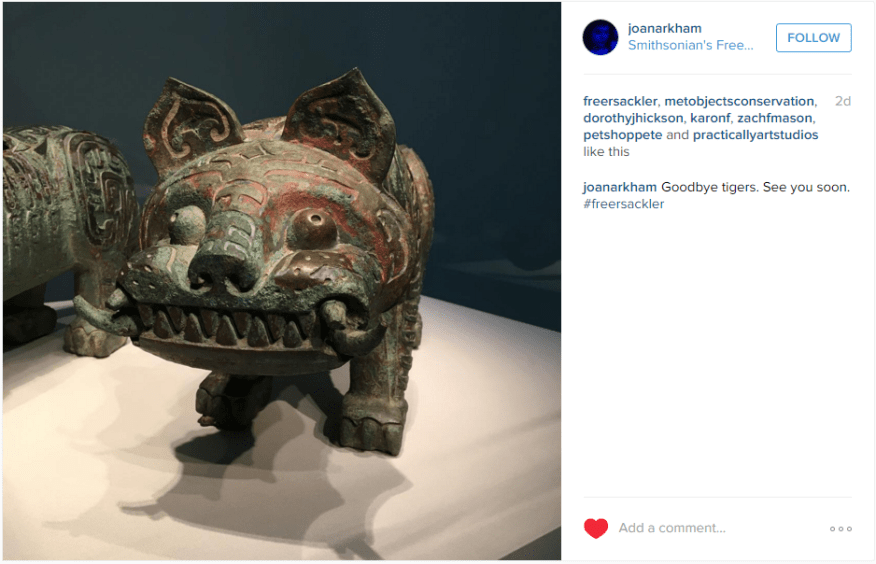 "Instagram picture of Chinese cast bronze tiger with bulging eyes and jagged teeth. ""Goodbye tigers. See you soon."""