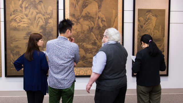 Three interns view Chinese landscape paintings with associate curator for Chinese Painting and Calligraphy, Stephen Allee