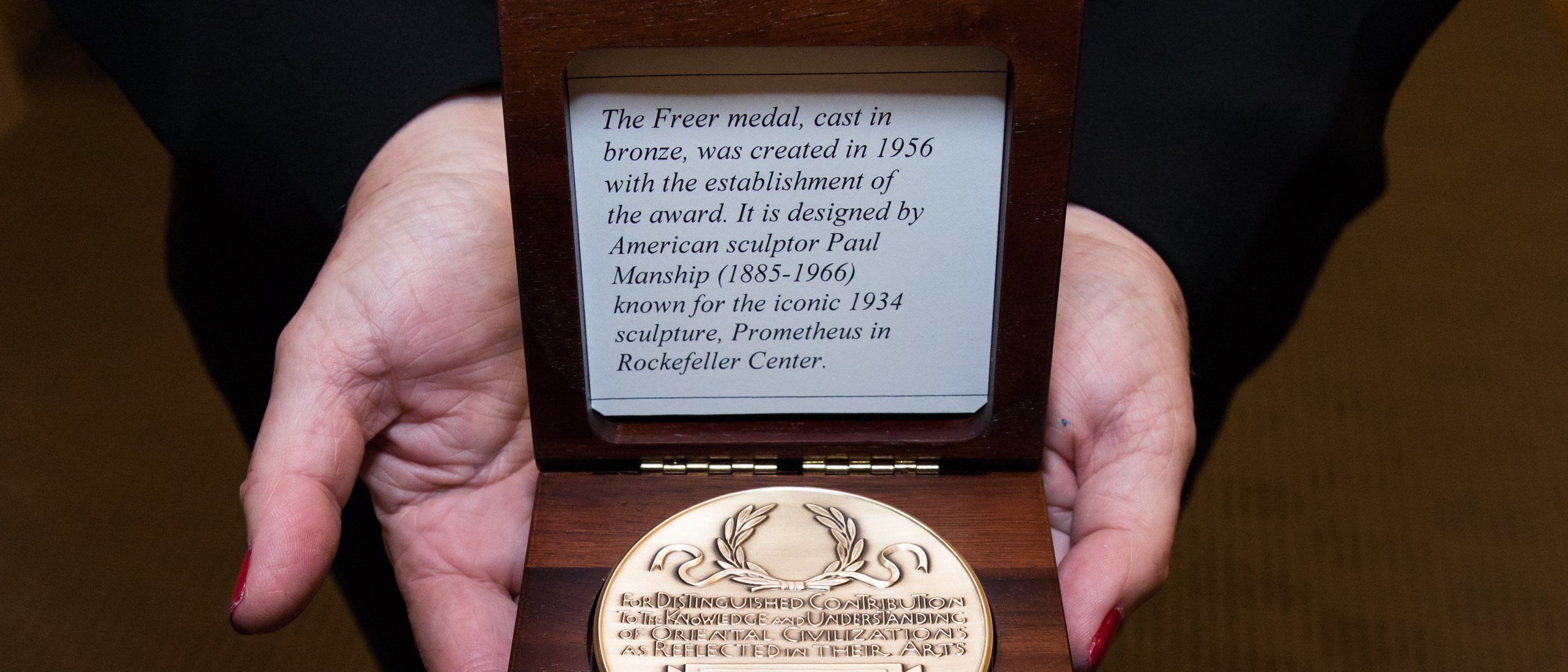 gold medal in a wooden box