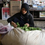 Woman selling grape leaves