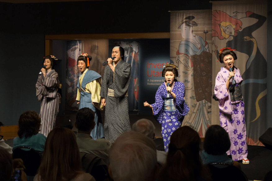 Four actresses and an actor singing passionately