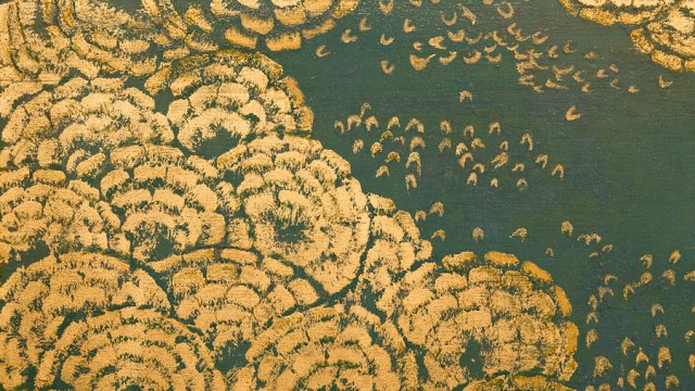 Floral detail in gold on turquoise from the Peacock Room.