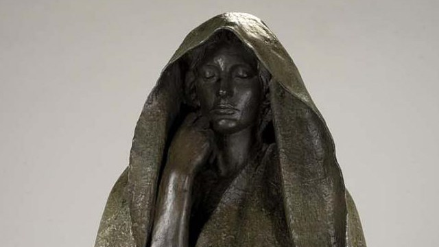 bronze hooded figure