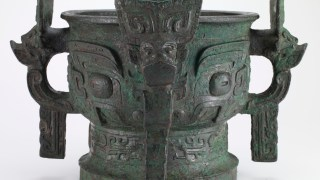 Richly Richly decorated bronze container.